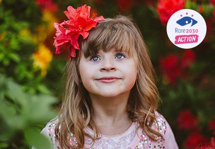 Una niña con una flor